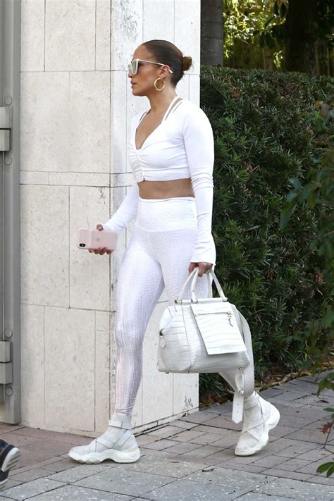 Jennifer Lopez in a Silver Leggings Arrives at a Gym in