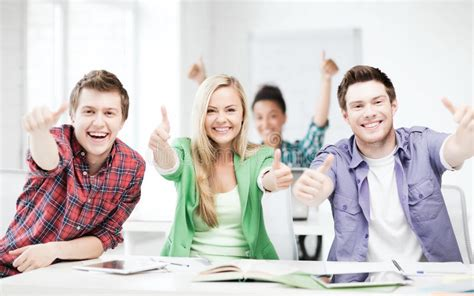 Students Showing Thumbs Up At School Stock Photo - Image