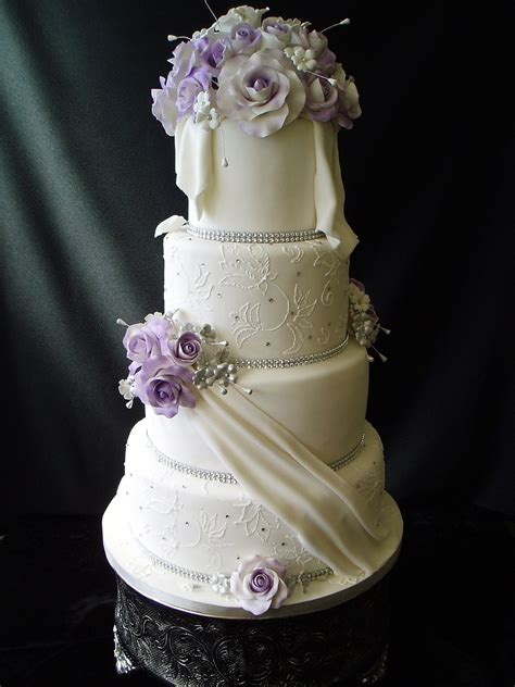 Wedding Cake With Purple Roses - CakeCentral
