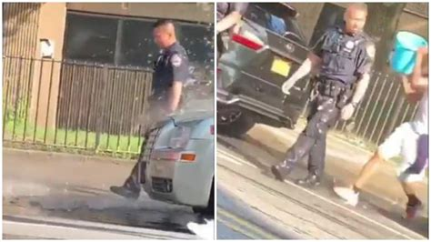 Videos of water being dumped on police officers create